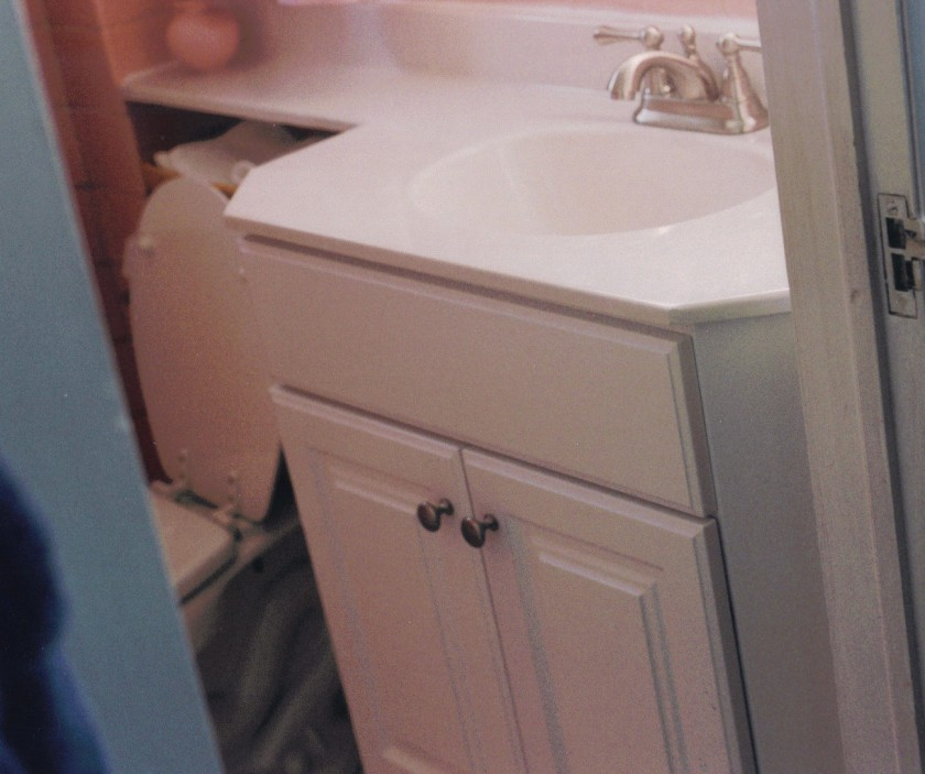 The vanity is white now and could stay that color with a new paint job, but a fresh color in the wallpaper might be fun.
