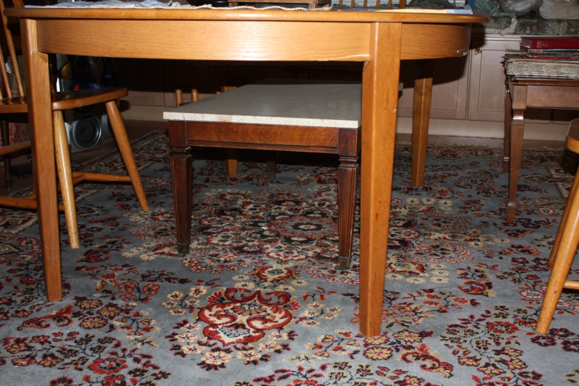 The marble coffee table has been stored under the dining room table before.