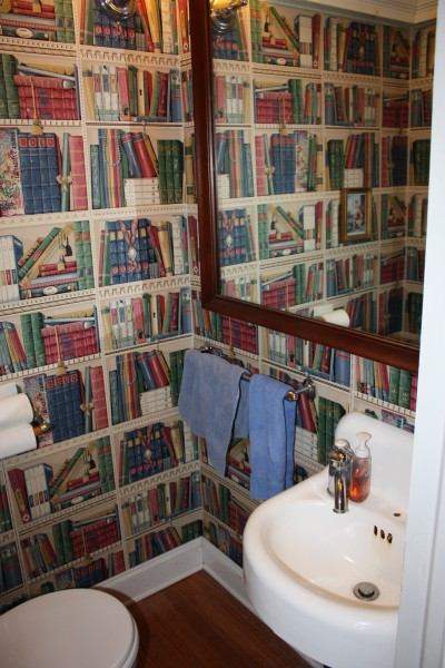 The library wall paper in the powder room makes it seem larger than its tiny self but is a bit gloomy.