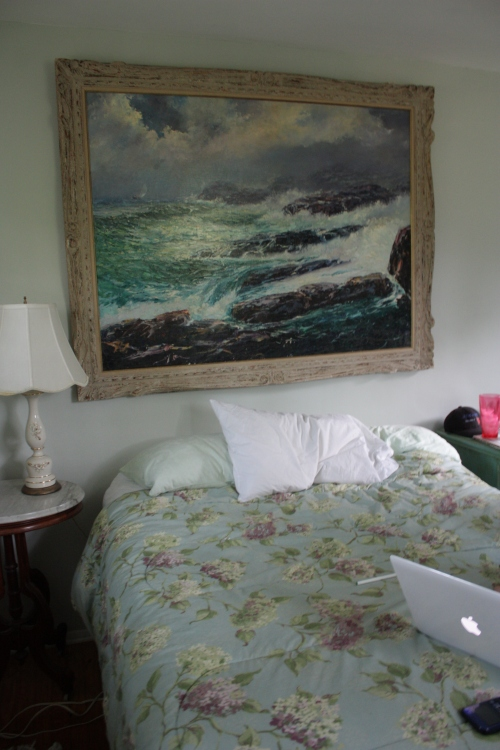 If we connected the headboard it would bang against the frame of this Kolean seascape.