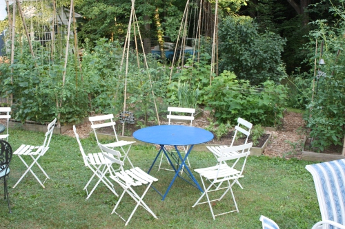 Our blue metal garden table flanked by French folding chairs.