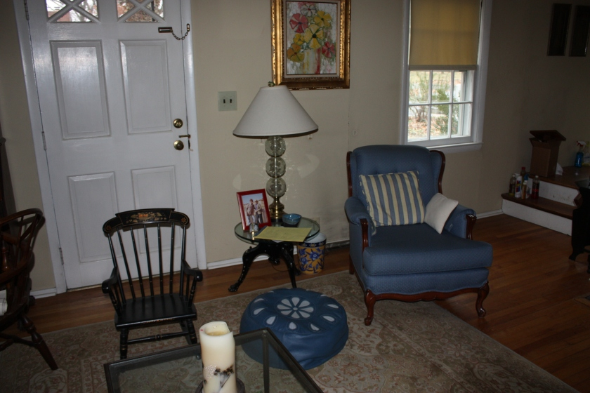 The front door and central window in the living room have exchanged places.