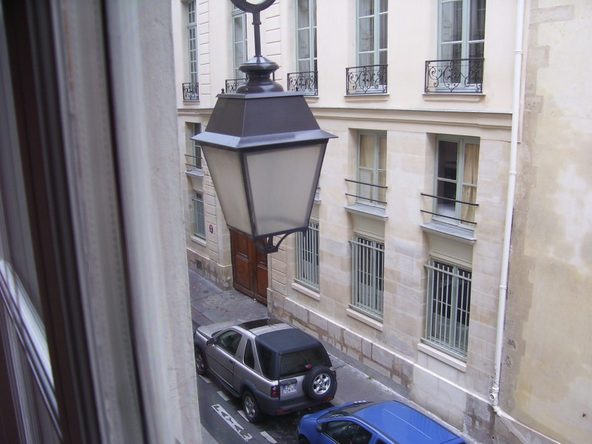 Looking onto rue de Saintonge -- lighting fixture, iron railings --