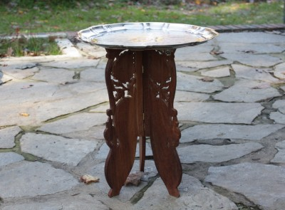 A tray on a carved pedestal could double as a small table.