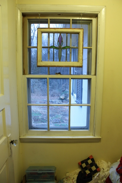 The new door to the bedroom will take the place of this window.