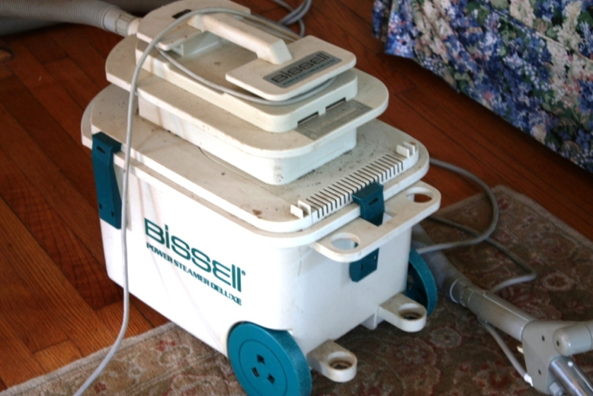 We're going to use our old Bissell and my personal rug cleaner to further clean the rug.