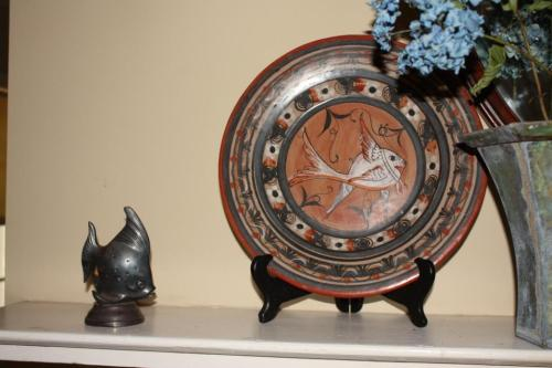 This fishy duo, a tarnished silver toothpick holder and a ceramic plate, have done mantel duty together.