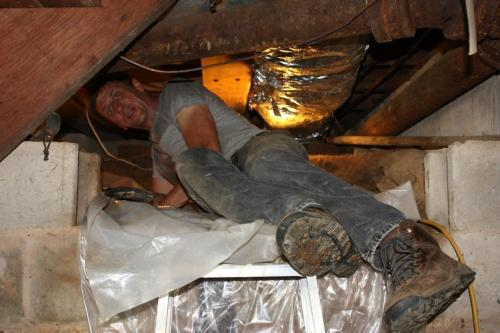 The existing crawlspace is even tight for Charlie who weighs in at 155 pounds.