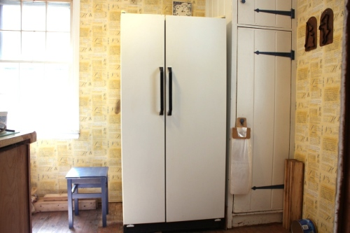 The old refrigerator in the old kitchen which has since become the mudroom.