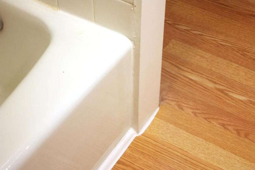 The trim and edges are well-caulked with silicone caulk.