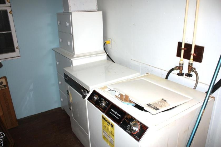Washer and dryer in The Cottage are apartment-sized models.
