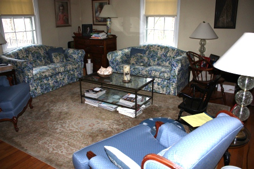 The old living room set up had buff colored shades (no curtains) and stingy-sized throw pillows.
