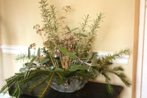 This arrangement featuring fragrant rosemary is ultimately destined for the buffet table.