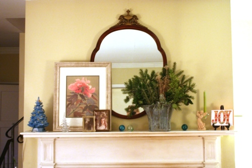 I bought the mirror over the mantle at a house auction for $90.  I love the unusual shape.