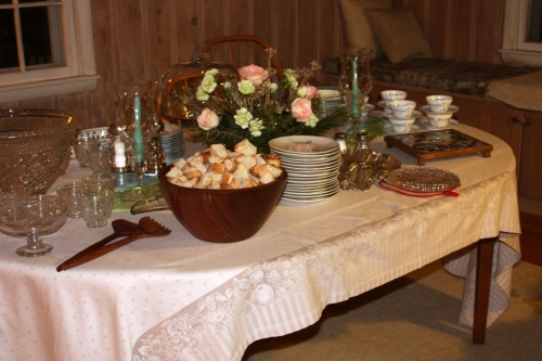 The dining room table set for a buffet.