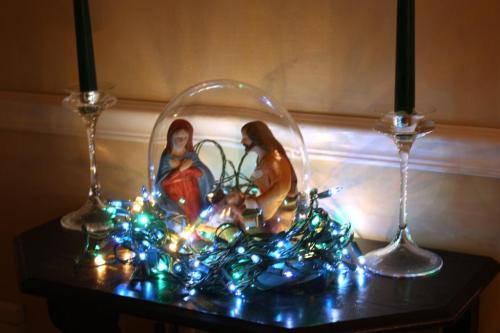 The Holy Family surrounded by lights.