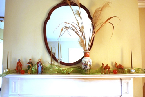 Dried grasses add height and interest to the mantel.