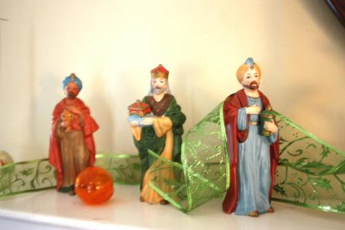 Three Kings bring gifts to the Christ child.