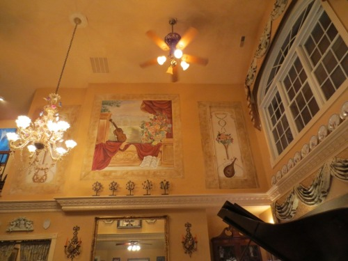 Three musical murals were painted in the large wall over the fireplace.