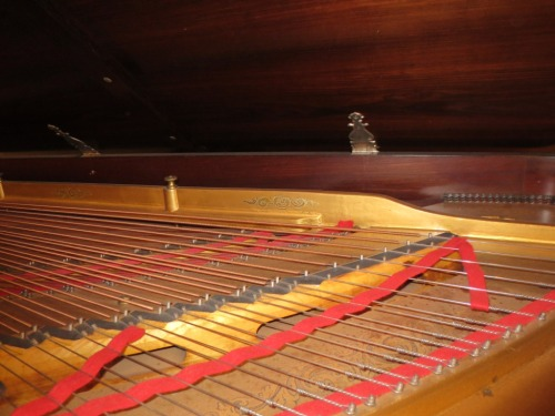 The inside of the Knabe concert grand featured inlaid scrolls in the metalwork.