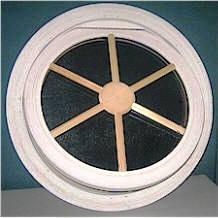 Round window with wagon wheel insert.