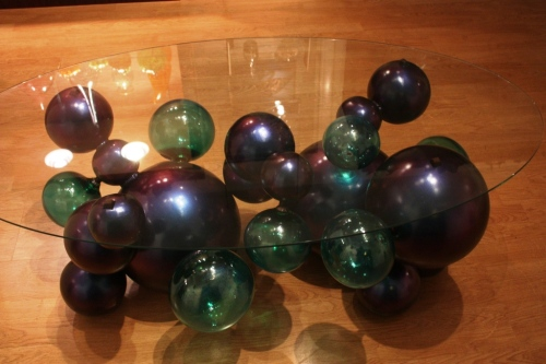 The base of this table is blown glass balls.