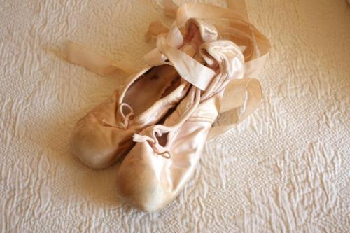 Well-used pink satin toes shoes