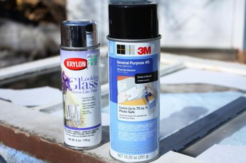 The Looking Glass spray paint by Krylon gives a mirror finish.  Spray adhesive heolds paper to glass.
