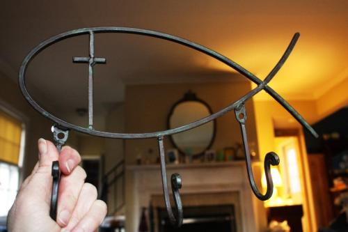 I found thisfish-shaped  rack for a few dollars at a discount store with the hopes of hanging it in an outdoor chapel.