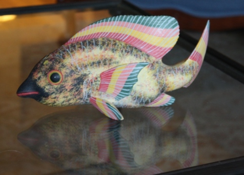 "A brightly colored fish (about 8"" long)."