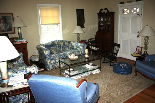 The living room before the renovation. The secretary was tucked into the far corner near the front door.