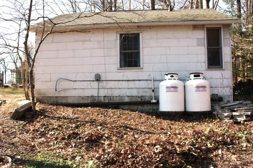 Our propane tanks sit behind the Cottage unseen from the house.
