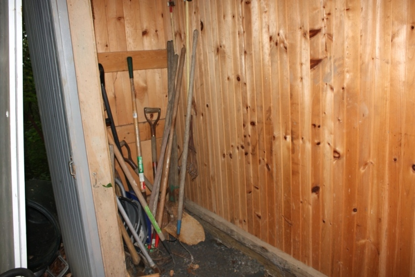 The long-handled tools could be stored on the wall along with our wooded ladder.