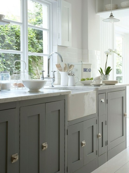 Simple shaker style lower cabinets in a dark or medium grey