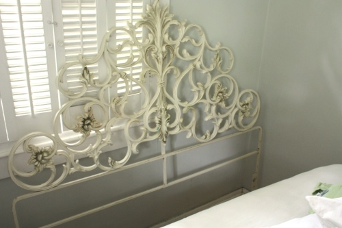 An arabesque iron headboard.