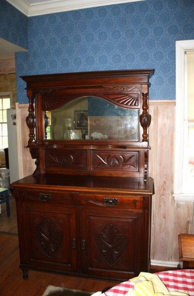 We have this beautiful vintage, dare I say antique, sideboard.
