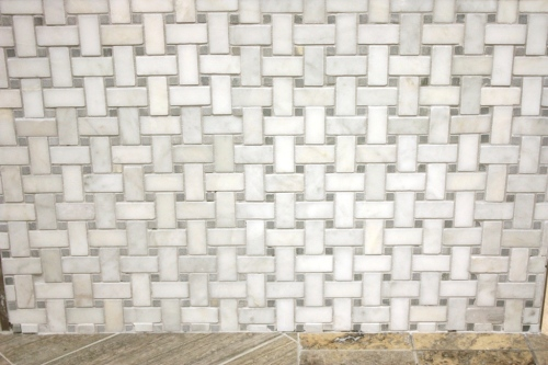 I like this marble basketweave tile for the master bathroom floor.
