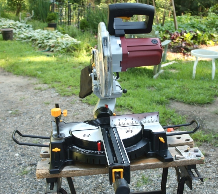 The fellows moved the miter saw near the back door.