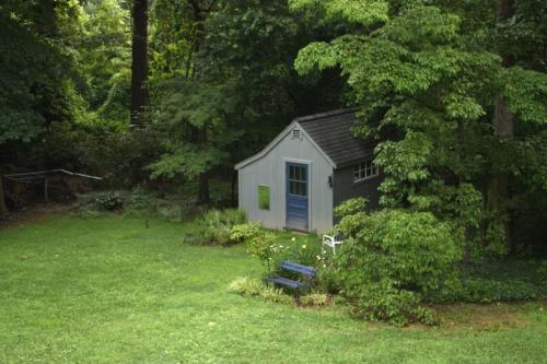 The blue bench was hardly used in its spot in front of the Children's Garden near the shed.