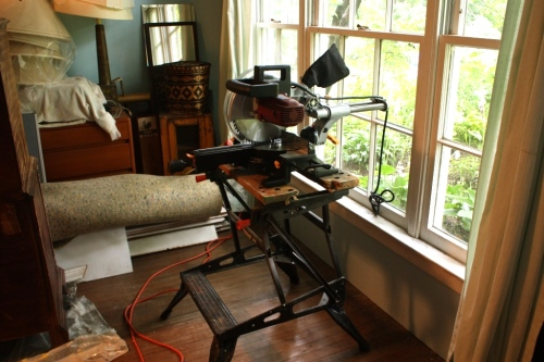 I usually keep the miter saw in the cottage and open the window when I need to make a cut.