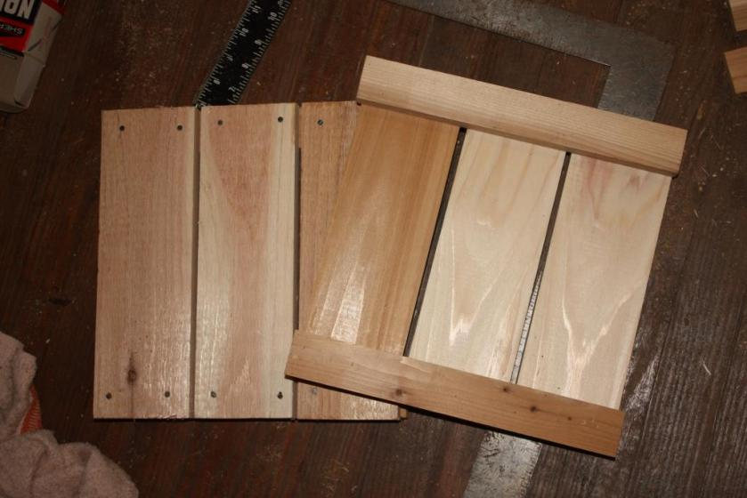 Screw or nail wide boards to the 1 by 2 furring strips to form a square.