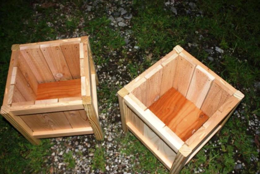 Inside the planters with the bottoms inserted.