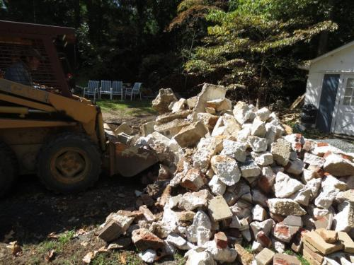 Tons of rubble at the back of our driveway divided the cottage from the house.