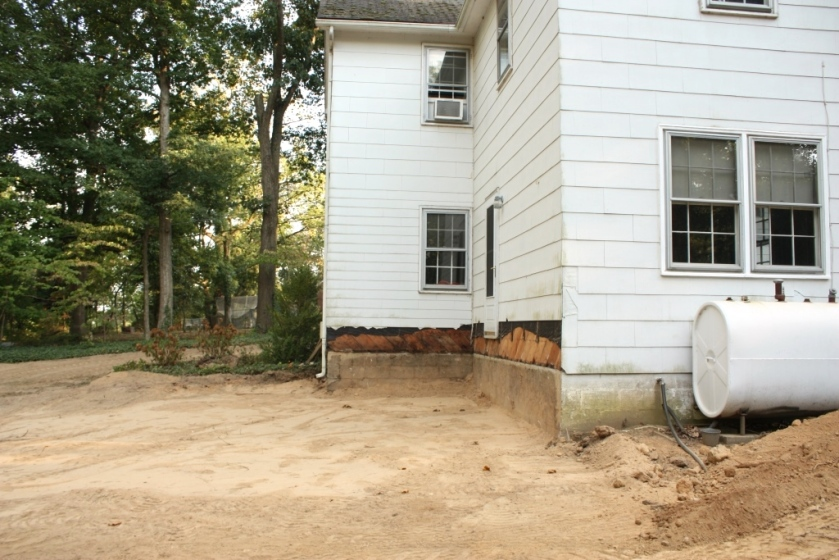 After the porch was demolished and the ground was graded.