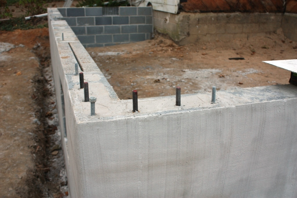wall in the foreground with the naked wall on the original foundation