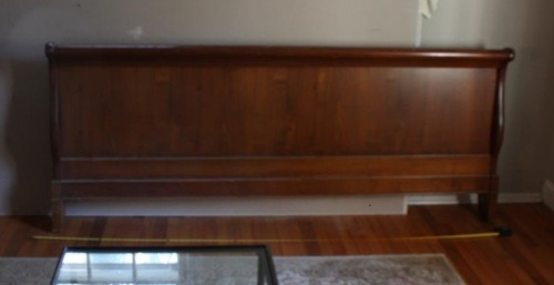 The footboard of the sleigh bed takes up a lot of visual space in the bedroom.