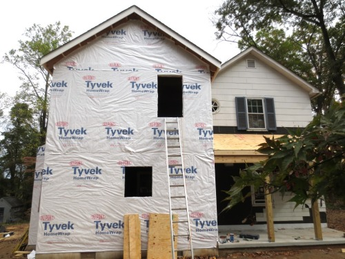 The Tyvex covers the sheathing before the windows are installed.