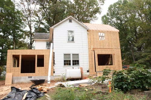 Back in October, 2013, the conservatory (left) is covered in plywood but the kitchen wing (right has only trusses, no roof.