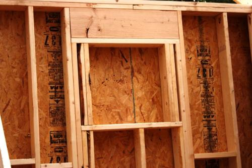 """Both new bathrooms have bird's eye windows which have a special framing. They fit inside the square made from 2"""" by 6"""" studs."""