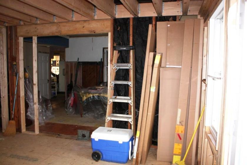 The sheathing has been removed from the conservatory wall and a 5-foot opening into the dining room.
